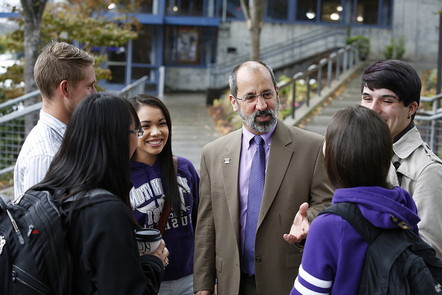 Photo os Chancellor Pagano talking with students on campus